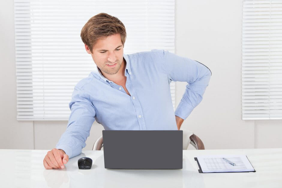 Business man Suffering from backache while working on Laptop